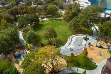 A series of urban rooms are organized around the main circular promenade which surrounds the central civic green.