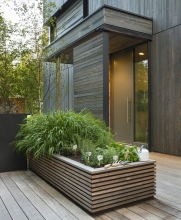 A large custom planter provides space for an herb garden beside the kitchen.