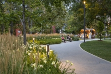 "Drifts of ornamental grasses and perennials create softly veiled spaces within the dappled shade of the ""Grove"""