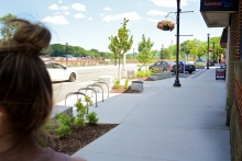 Widened sidewalks and bump-outs provide space for trees and seating in a new pedestrian-oriented environment