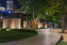 Three discrete sculptural washroom pavilions are positioned amongst the existing trees and create a focal point.