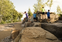 In addition to mediating the elevation change between the upper and lower park, the Bluff promotes unstructured play.