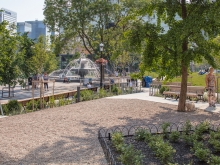 The elevated Mural Garden behind the Flatiron Building provides a gravel surface where locals can discretely relieve their pets before entering the rest of the park, keeping lawns and other park surfaces clean and inviting for other park visitors.
